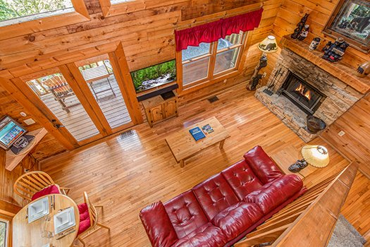 Overhead view of the living room at Cupid's Crossing, a 1-bedroom cabin rental located in Pigeon Forge