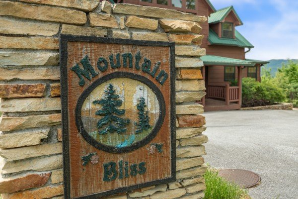 Custom sign at Mountain Bliss, a 2 bedroom cabin rental located in Pigeon Forge