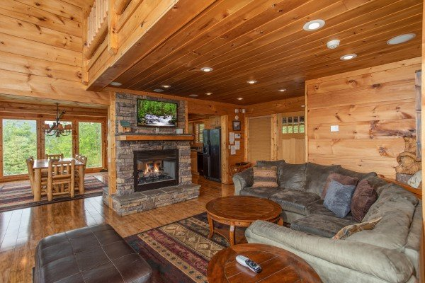 Fireplace and TV in the living room at Mountain Bliss, a 2 bedroom cabin rental located in Pigeon Forge