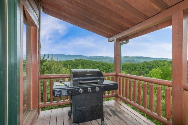 Grill on a covered deck at Mountain Bliss, a 2 bedroom cabin rental located in Pigeon Forge