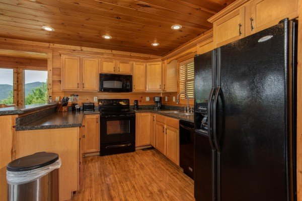 Kitchen with black appliances at Mountain Bliss, a 2 bedroom cabin rental located in Pigeon Forge