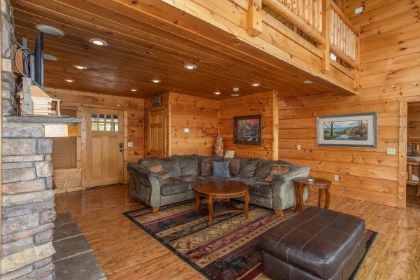 Sectional sofa in the living room at Mountain Bliss, a 2 bedroom cabin rental located in Pigeon Forge
