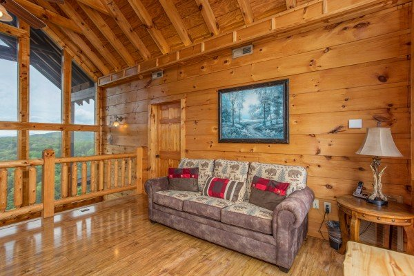 Sofa in the loft area at Mountain Bliss, a 2 bedroom cabin rental located in Pigeon Forge