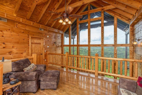 Loft with large windows at Mountain Bliss, a 2 bedroom cabin rental located in Pigeon Forge