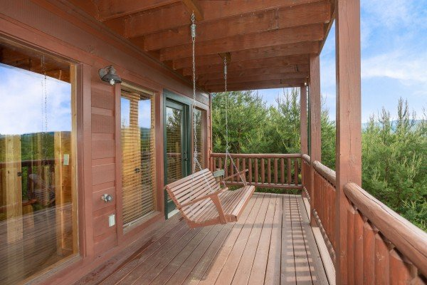 Porch swing at Mountain Bliss, a 2 bedroom cabin rental located in Pigeon Forge
