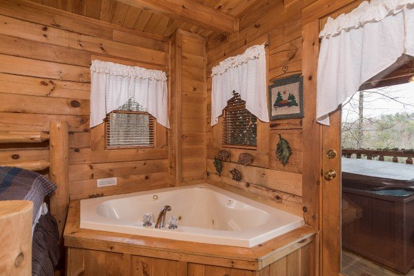 Jacuzzi tub in a bedroom at Moose Tracks, a 1 bedroom cabin rental located in Gatlinburg