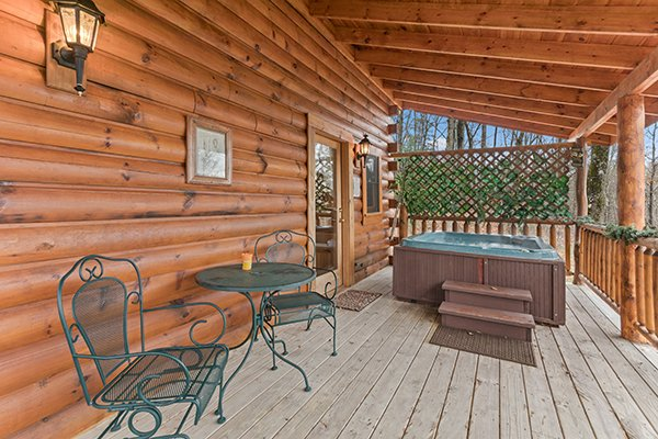 Covered deck with bistro set and hot tub at Moose Tracks, a 1 bedroom cabin rental located in Gatlinburg
