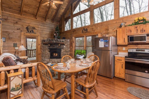 Dining table for four in the kitchen at Moose Tracks, a 1 bedroom cabin rental located in Gatlinburg