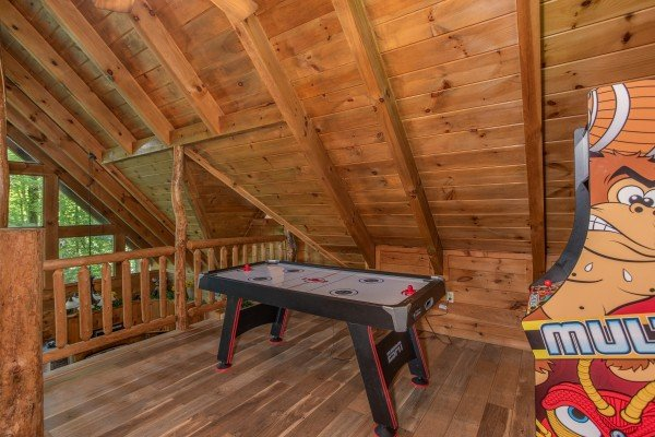 Game loft with air hockey and an arcade game at Moose Tracks, a 1 bedroom cabin rental located in Gatlinburg