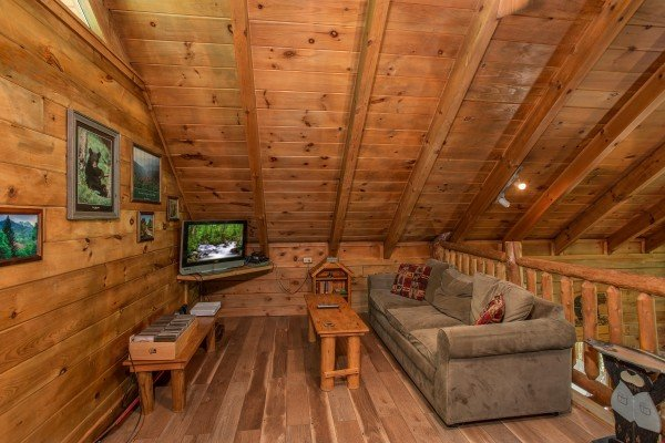 Loft space with a sofa bed and TV at Moose Tracks, a 1 bedroom cabin rental located in Gatlinburg