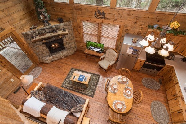 Looking down onto the open concept main floor at Moose Tracks, a 1 bedroom cabin rental located in Gatlinburg