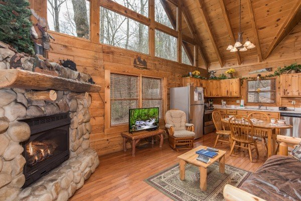 Main floor with living room, dining space, and kitchen at Moose Tracks, a 1 bedroom cabin rental located in Gatlinburg