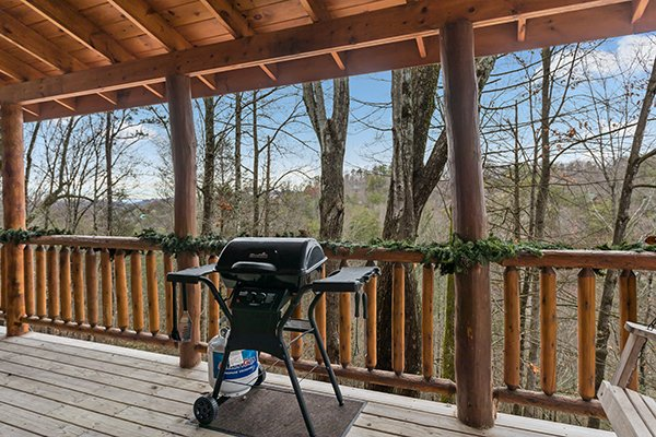 Propane grill on a covered deck at Moose Tracks, a 1 bedroom cabin rental located in Gatlinburg