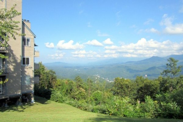 Looking down the hill and over at the mountains at Summit Condo 1208, a 2 bedroom cabin rental located in Gatlinburg