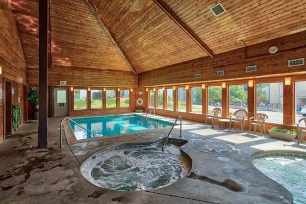 Indoor pool and spa for guests at Summit Condo 1208, a 2 bedroom cabin rental located in Gatlinburg