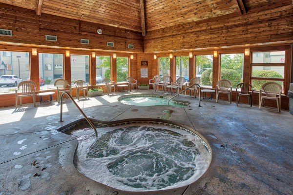 Indoor whirlpool spas for guests at Summit Condo 1208, a 2 bedroom cabin rental located in Gatlinburg