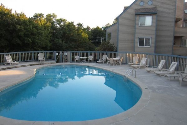 Outdoor pool for guests at Summit Condo 1208, a 2 bedroom cabin rental located in Gatlinburg