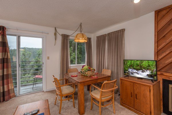 Dining set for four in the living space at Summit Condo 1208, a 2 bedroom cabin rental located in Gatlinburg