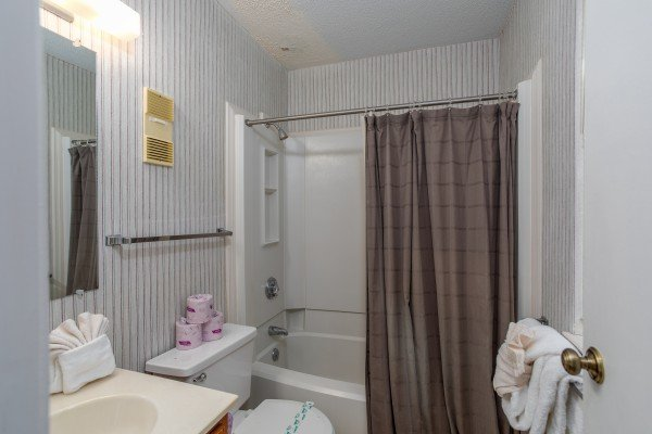 Bathroom with a tub and shower at Summit Condo 1208, a 2 bedroom cabin rental located in Gatlinburg