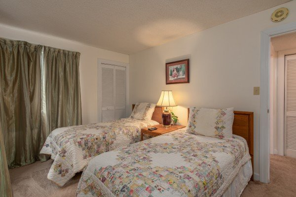 Bedroom with two twin beds at Summit Condo 1208, a 2 bedroom cabin rental located in Gatlinburg