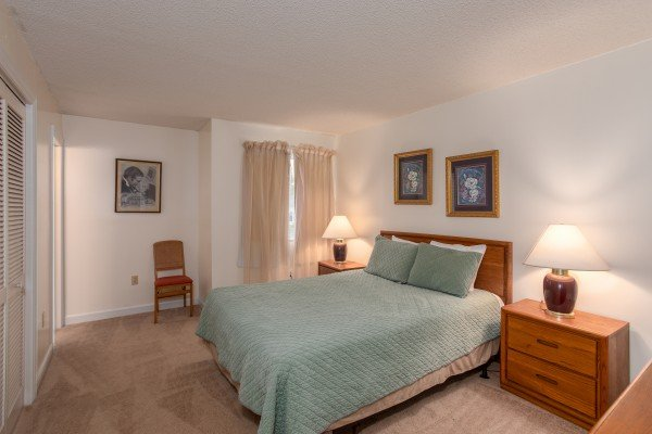 King bed in a bedroom at Summit Condo 1208, a 2 bedroom cabin rental located in Gatlinburg