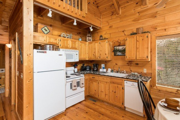 Kitchen with white appliances at Alone Time, a 1 bedroom cabin rental located in Pigeon Forge