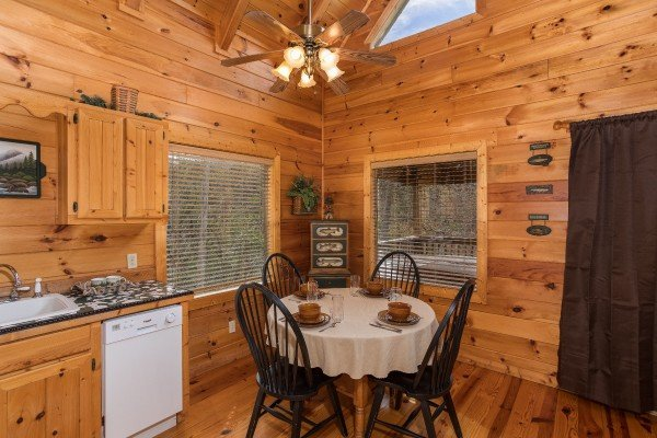 Dining space with seating for four at Alone Time, a 1 bedroom cabin rental located in Pigeon Forge