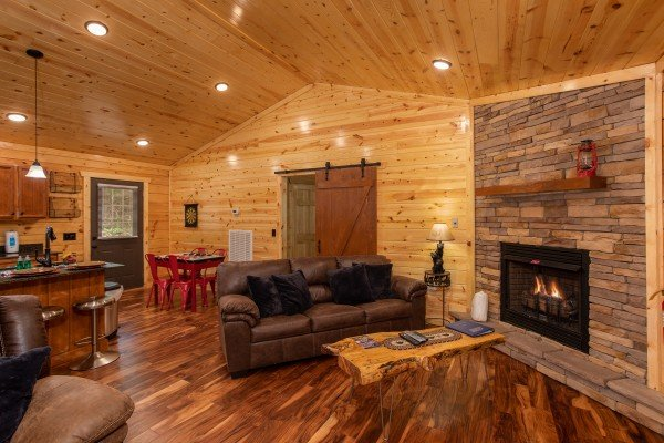 Living room with sofa and fireplace at Paws on the Porch, a 2 bedroom cabin rental located in Gatlinburg