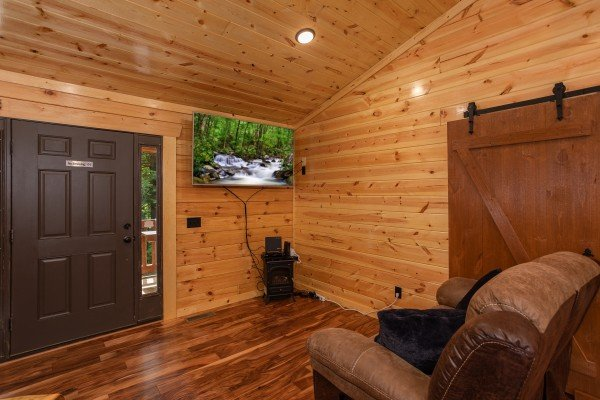 Living room with TV and sofa at Paws on the Porch, a 2 bedroom cabin rental located in Gatlinburg