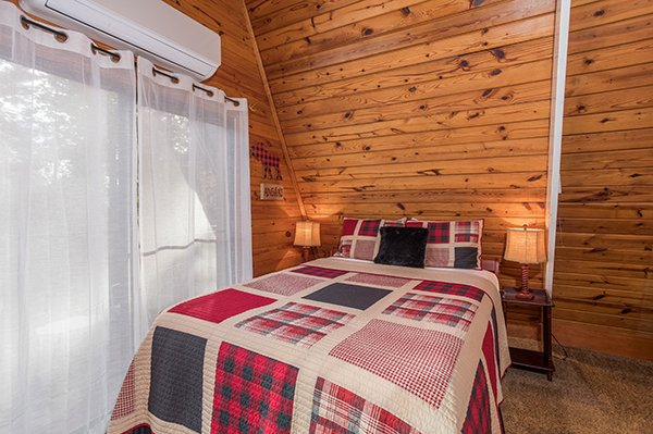 Bed with two small bedside tables at 2 The Mountains, a 3 bedroom cabin rental located in Gatlinburg