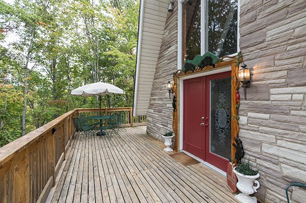 Deck with dining area at 2 The Mountains, a 3 bedroom cabin rental located in Gatlinburg