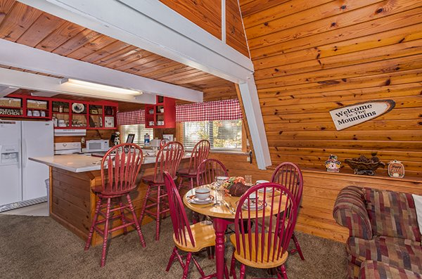 Dining area and kitchen at 2 The Mountains, a 3 bedroom cabin rental located in Gatlinburg