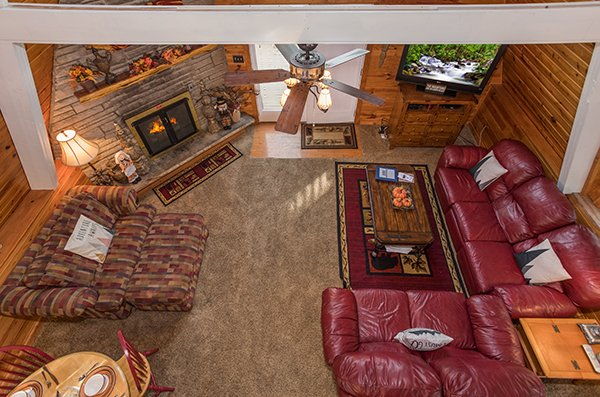 Living room view from the loft at 2 The Mountains, a 3 bedroom cabin rental located in Gatlinburg