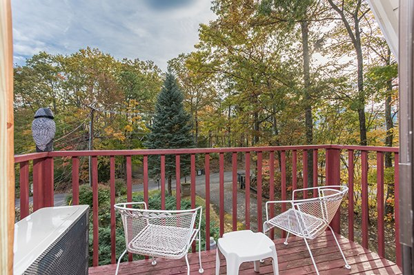 Outdoor deck seating at 2 The Mountains, a 3 bedroom cabin rental located in Gatlinburg