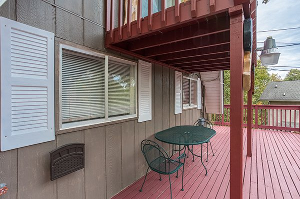 Outdoor deck dining area at 2 The Mountains, a 3 bedroom cabin rental located in Gatlinburg