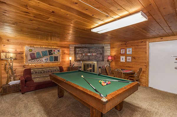 Pool table in the game room at 2 The Mountains, a 3 bedroom cabin rental located in Gatlinburg