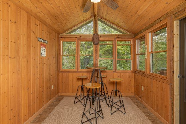 Sunroom with seating for four at Cubs' Crib, a 3 bedroom cabin rental located in Gatlinburg