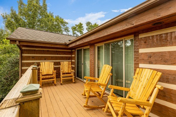 Deck with four rocking chairs at Cubs' Crib, a 3 bedroom cabin rental located in Gatlinburg