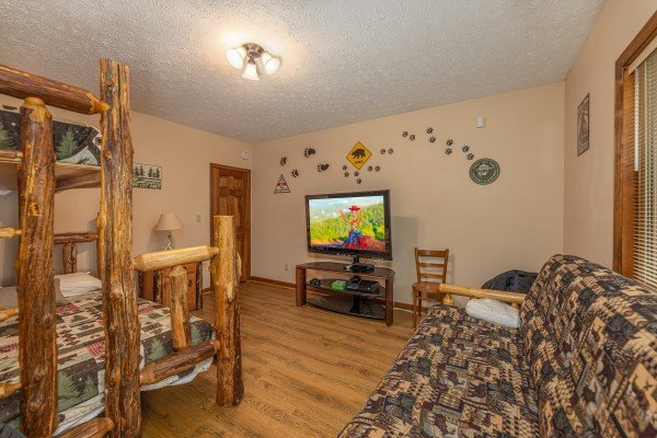 Room with a bunk bed and futon at Cubs' Crib, a 3 bedroom cabin rental located in Gatlinburg