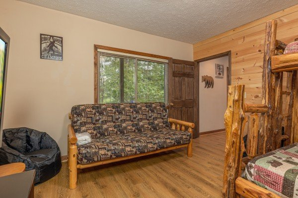 Bunk room with a futon at Cubs' Crib, a 3 bedroom cabin rental located in Gatlinburg