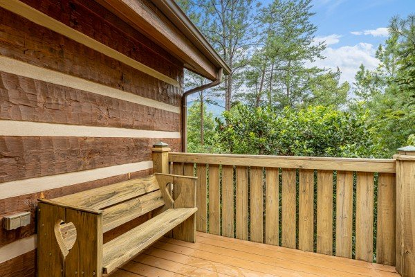 Bench on a deck at Cubs' Crib, a 3 bedroom cabin rental located in Gatlinburg