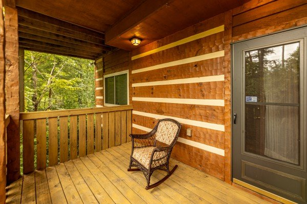 Rocking chair on a deck at Cubs' Crib, a 3 bedroom cabin rental located in Gatlinburg