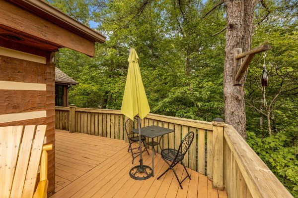 Deck table and chairs for two at Cubs' Crib, a 3 bedroom cabin rental located in Gatlinburg