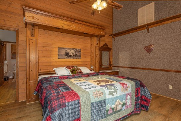King bed and night stand at Cubs' Crib, a 3 bedroom cabin rental located in Gatlinburg