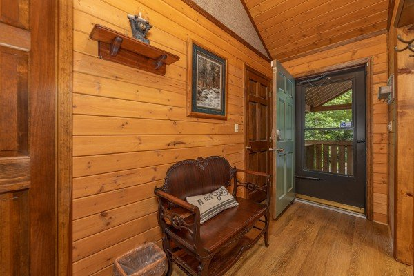 Foyer with a bench at Cubs' Crib, a 3 bedroom cabin rental located in Gatlinburg