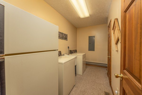 Laundry room with a fridge, washer, and dryer at Cubs' Crib, a 3 bedroom cabin rental located in Gatlinburg