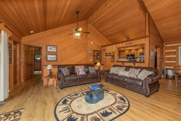 Two sofas in a living room at Cubs' Crib, a 3 bedroom cabin rental located in Gatlinburg