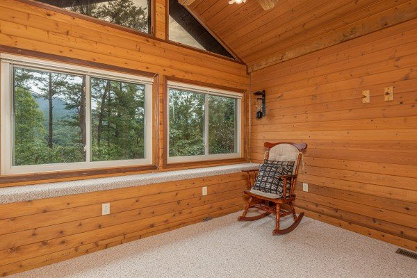 Rocking chair in a large room at Cubs' Crib, a 3 bedroom cabin rental located in Gatlinburg
