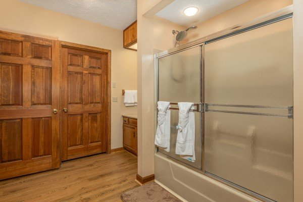 Bathroom with a tub and shower at Cubs' Crib, a 3 bedroom cabin rental located in Gatlinburg