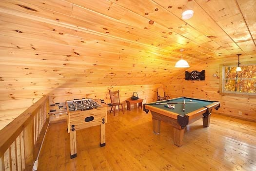 pool table and foosball in game room at licklog hollow a 1 bedroom cabin rental located in pigeon forge